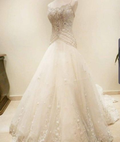 Buy Sell Wedding Dress Sharjah UAE White Silk Fit&Flare Wedding Dress Size M